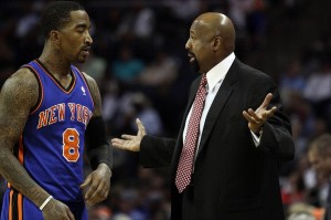 Apr 26, 2012; Charlotte, NC, USA New York Knicks head coach Mike Woodson talks with New York Knicks shooting guard J.R. Smith (8) after a foul call during the first half. The New York Knicks defeated the Charlotte Bobcats 104-84 at Time Warner Cable Arena. Mandatory Credit: Jeremy Brevard-USA TODAY Sports