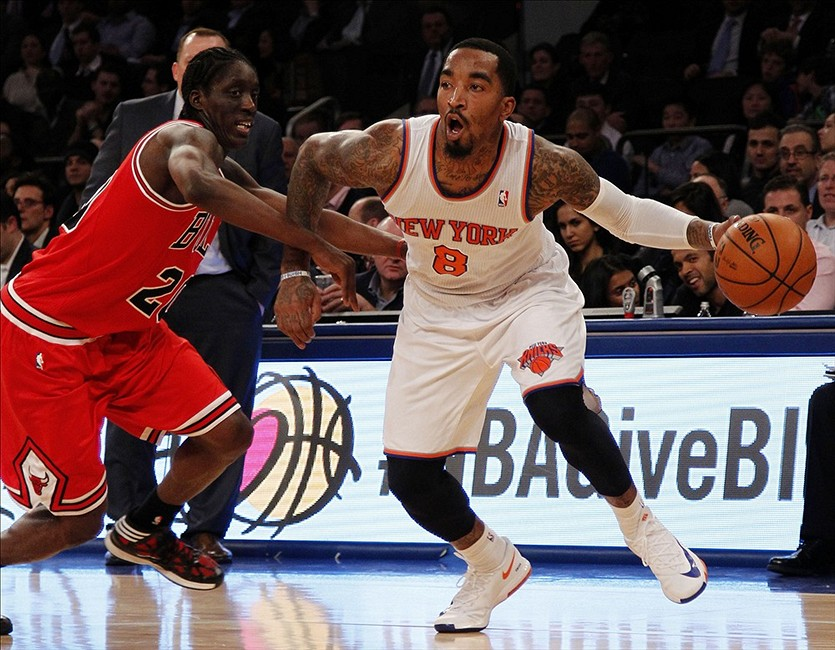 Dec 11, 2013; New York, NY, USA;New York Knicks shooting guard J.R. Smith (8) drives to the basket against Chicago Bulls small forward Tony Snell (20) in the second half of NBA game at Madison Square Garden. Mandatory Credit: Noah K. Murray-USA TODAY Sports