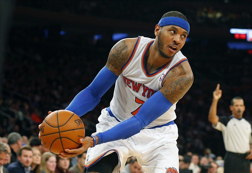 Jan 7, 2014; New York, NY, USA; New York Knicks small forward Carmelo Anthony (7) inbounds the ball during the second half against the Detroit Pistons at Madison Square Garden. New York Knicks defeat the Detroit Pistons 89-85. Mandatory Credit: Jim O